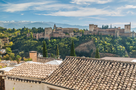 Alhambra palace in Granada, Spain. Sierra Nevada mountains visible.