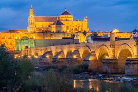 Evening view of the Mosque-Cathedral and Roman Bridge in Cordoba, Spain Editorial
