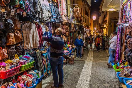 GRANADA, SPAIN - NOVEMBER 2, 2017: Various stalls in Calle Caldereria Nueva street in Granada.