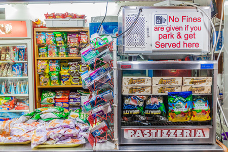 """MDINA, MALTA - NOVEMBER 10, 2017: No Fines are given if you park and get Served here"""" in a small shop in Mdina in the Northern Region of Malta"""