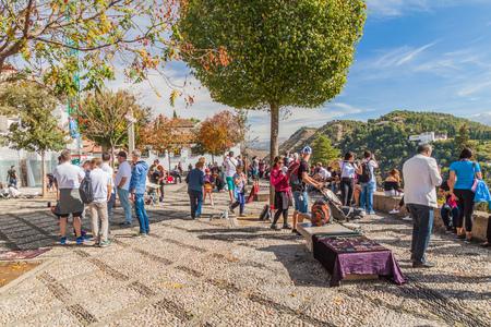 GRANADA, SPAIN - NOVEMBER 3, 2017: People at Mirador San Nicolas viewpoint in Granada, Spain