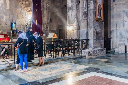 TATEV, ARMENIA - JULY 8, 2017: Priest blessing devotees at Tatev monastery, Armenia Redactioneel
