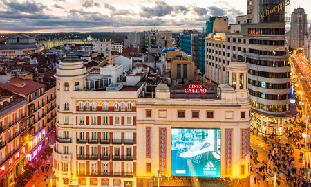 MADRID, SPAIN - OCTOBER 22, 2017: Evening at Calle Gran Via street, Carrion Building and others in Madrid