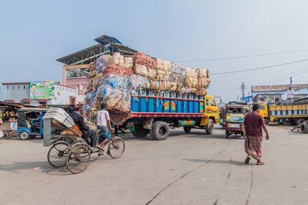 KHULNA, BANGLADESH - NOVEMBER 12, 2016: Street traffic near the train station in Khulna, Bangladesh