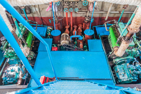 RUPSA, BANGLADESH - NOVEMBER 13, 2016: Engine room of M. V. DINGHY ship of The Bengal Tours Ltd. on Rupsa river, Bangladesh