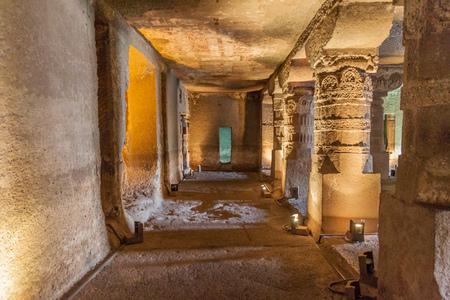 AJANTA, INDIA - FEBRUARY 6, 2017: Monastery (vihara) carved into a cliff in Ajanta, Maharasthra state, India