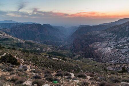 Sunset at  Wadi Dana canyon in Dana Biosphere Reserve, Jordan Фото со стока