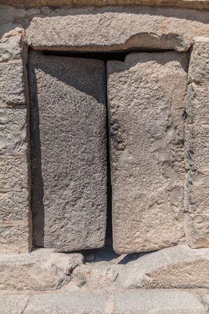 Stone door of Qasr al-Azraq (Blue Fortress), fortress located in the desert of eastern Jordan.