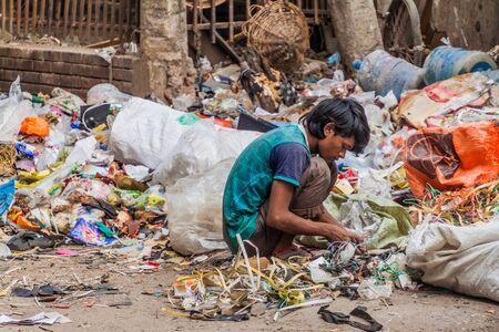 DHAKA, BANGLADESH - NOVEMBER 20, 2016: Local scavenger collects garbage in Dhaka, Bangladesh