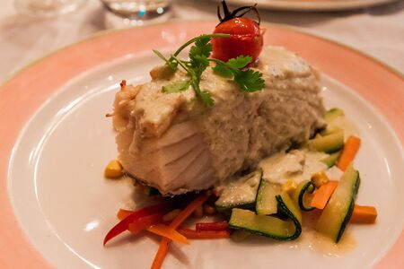 Cod fish (bacalao) with vegetables, meal in Portugal