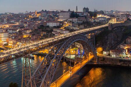 Evening view of Dom Luis bridge over river Douro in Porto, Portugal