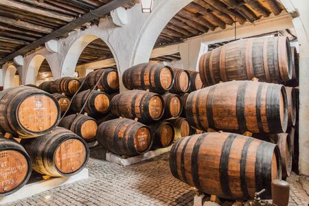 VILA NOVA DE GAIA, PORTUGAL - OCTOBER 18, 2017: Barrels of Port wine at Ramos Pinto winery cellar in Vila Nova de Gaia near Porto.