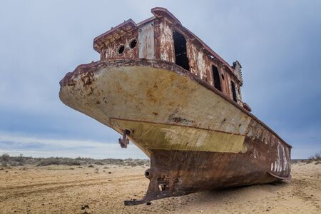 Rusty abandoned ship at the Ship cemetery at the former Aral sea coast in Moynaq (Mo'ynoq or Muynak), Uzbekistan