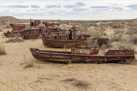 Rusty ships at the ship graveyard in former Aral sea port town Moynaq (Mo'ynoq or Muynak), Uzbekistan