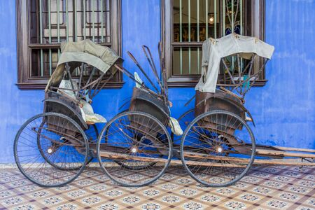 Rickshaws at the Cheong Fatt Tze Mansion (The Blue Mansion) in George Town, Malaysia