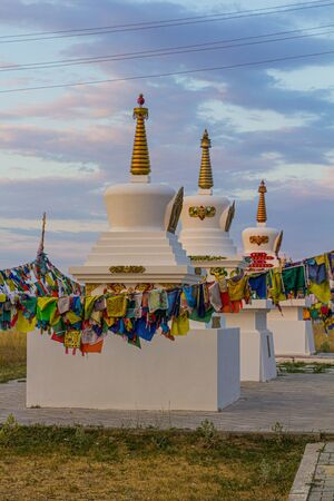 Stupas and flags near Syakusn Syume, Geden Sheddup Choikorling Monastery, Tibetan Buddhist monastery in Elista, Republic of Kalmykia, Russia