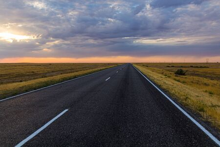 Sunset view of a road in russian steppe