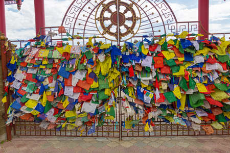 Buddhist flags at the gate of the Buddhist temple complex The Golden Abode of the Buddha Shakyamuni in Elista, Russia