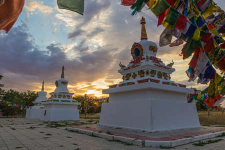 Stupas and flags near Syakusn Syume, Geden Sheddup Choikorling Monastery, Tibetan Buddhist monastery in Elista, Republic of Kalmykia, Russia