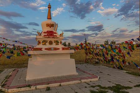 Stupa and flags near Geden Sheddup Choikorling Monastery, Tibetan Buddhist monastery in Elista, Republic of Kalmykia, Russia Фото со стока