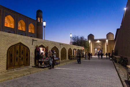 KHIVA, UZBEKISTAN - APRIL 25, 2018: Street market near the West Gate of the old town of Khiva, Uzbekistan. Editorial