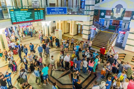 OMSK, RUSSIA - JULY 7, 2018: Crowd of people at the railway station in Omsk. Banco de Imagens