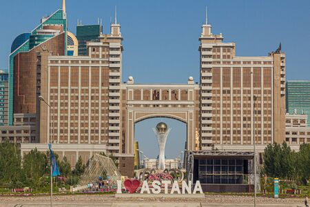 ASTANA, KAZAKHSTAN - JULY 9, 2018: Text I love Astana and modern buildings in Astana (now Nur-Sultan), capital of Kazakhstan.
