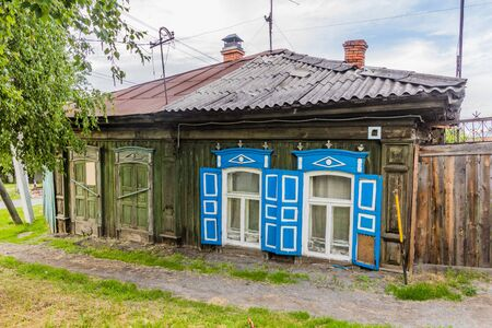 Typical old Russian wooden house in Tyumen city, Russia