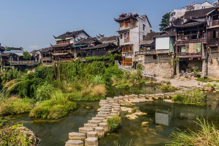 Stepping stones crossing a river in Furong Zhen town, Hunan province, China