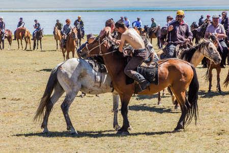 SONG KOL, KYRGYZSTAN - JULY 25, 2018: Horseback wrestling at the National Horse Games Festival at the shores of Son Kol Lake