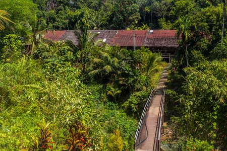 Traditional longhouse near Batang Rejang river, Sarawak, Malaysia Stock Photo