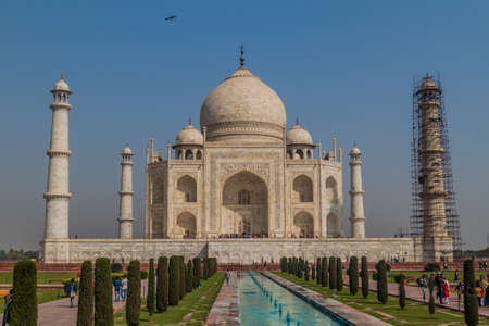 AGRA, INDIA - FEBRUARY 19, 2017: Tourists visit Taj Mahal in Agra, India