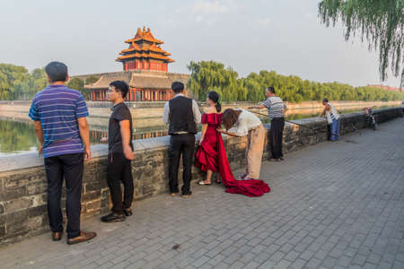 BEIJING, CHINA - AUGUST 28, 2018: Wedding shooting preparation at the Forbidden City moat in Beijing, China