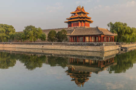 Corner tower of the Forbidden City in Beijing, China Редакционное
