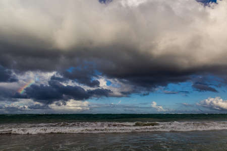 Rainbow and clouds at a sea