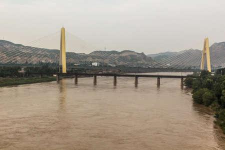 Hekou Grand bridge over Yellow river (Huang He) near Lanzhou, Gansu Province, China