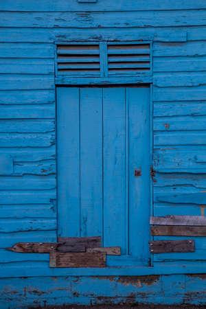 Door of blue wooden house in Jarabacoa, Dominican Republic