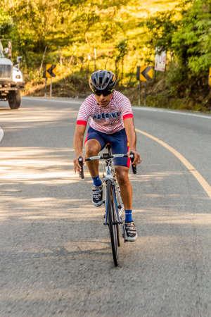 CONSTANZA, DOMINICAN REPUBLIC - DECEMBER 11, 2018: Cyclist on a road near Constanza, Dominican Republic Editorial