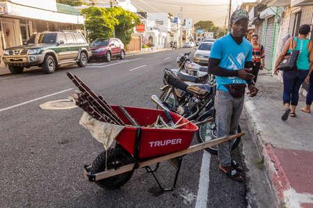 PUERTO PLATA, DOMINICAN REPUBLIC - DECEMBER 15, 2018: Sugar cane seller at a street in Puerto Plata, Dominican Republic