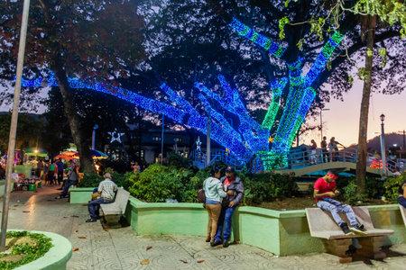 JARABACOA, DOMINICAN REPUBLIC - DECEMBER 9, 2018: Evening view of Parque Central (Central Park) in Jarabacoa, Dominican Republic