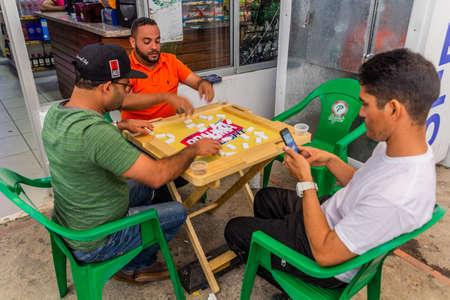 CONSTANZA, DOMINICAN REPUBLIC - DECEMBER 11, 2018: Local men playing dominos in Constanza, Dominican Republic