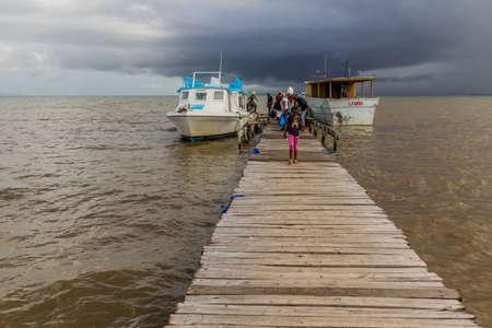 SABANA DE LA MAR, DOMINICAN REPUBLIC - DECEMBER 7, 2018: Wooden pier in Sabana de la Mar, Dominican Republic