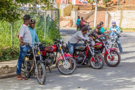SAMANA, DOMINICAN REPUBLIC - DECEMBER 5, 2018: Motorcycle taxis in Samana town, Dominican Republic