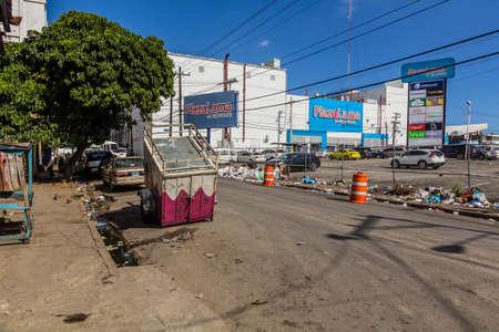 SANTO DOMINGO, DOMINICAN REPUBLIC - DECEMBER 2, 2018: Rubbish on a street in Santo Domingo, capital of Dominican Republic. Editorial