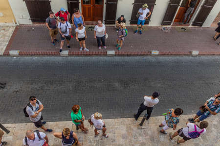 SANTO DOMINGO, DOMINICAN REPUBLIC - NOVEMBER 27, 2018: Aerial view of tourists on a street in the Colonial CIty of Santo Domingo, capital of Dominican Republic. Editorial