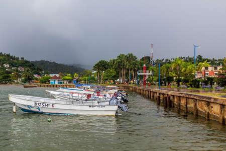 SAMANA, DOMINICAN REPUBLIC - DECEMBER 7, 2018: Boats at a pier in Samana town, Dominican Republic