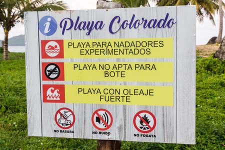 LAS GALERAS, DOMINICAN REPUBLIC - DECEMBER 6, 2018: Beach warning sign at Playa Colorada beach in Las Galeras, Dominican Republic Editorial