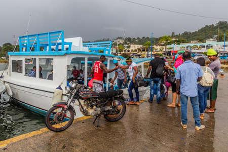 SAMANA, DOMINICAN REPUBLIC - DECEMBER 7, 2018: People enter ferry Samana - Sabana de la Mar, Dominican Republic