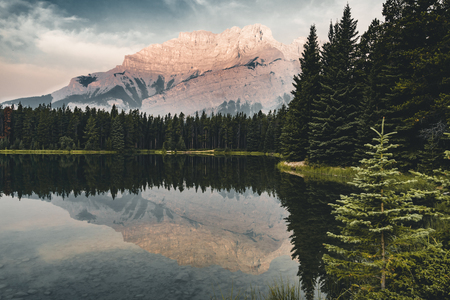 Two Jack Lake with mountain reflections along the Two Jack Lake