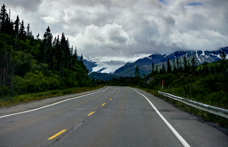 Empty street with view towards Glacier mountain panoarama in Ala Stock Photo